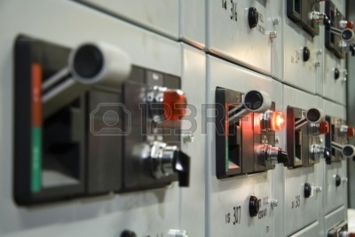 715045-close-up-of-electrical-control-panel-with-glowing-red-light